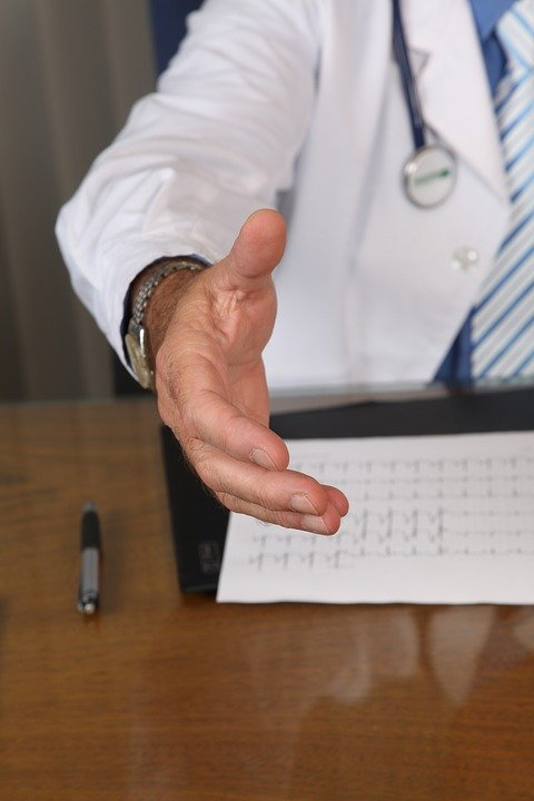 Business person reaching out hand