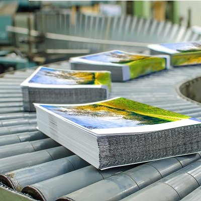 Marketing papers on a conveyor belt