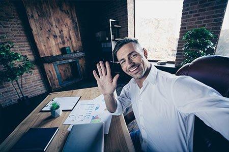 business man waving hello